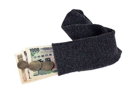 japanese currency: Japanese currency in a sock isolated on white background