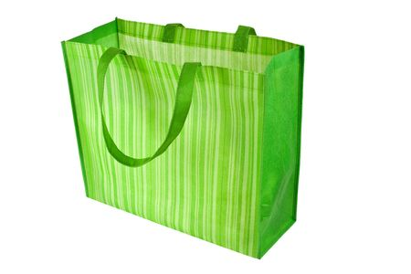 Empty green reusable shopping bag isolated on white background Фото со стока