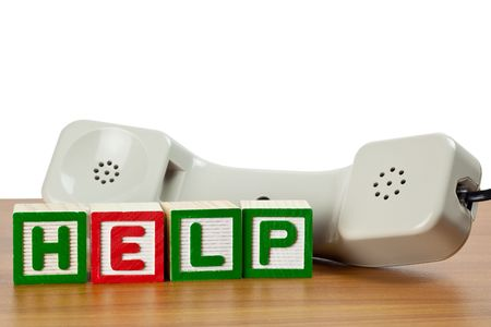 letter blocks: Phone handset with letter blocks HELP on a table Stock Photo