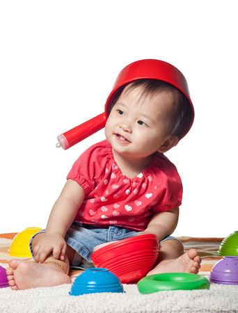 Playful Chinese toddler girl isolated on white background