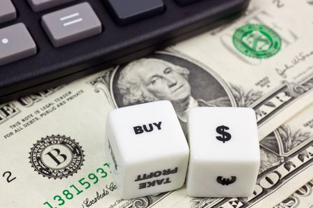 US currency with calculator and dice Stock Photo