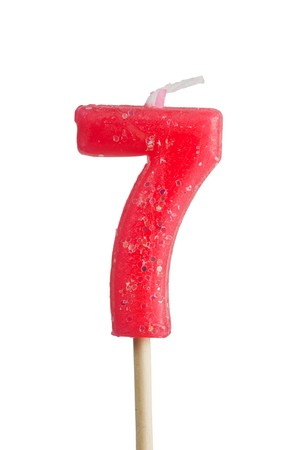arabic numeral: Birthday candle number seven isolated on white background