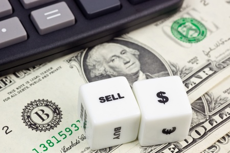 US currency with calculator and dice photo