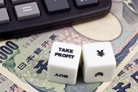 japanese currency: Japanese currency with calculator and dice showing TAKE PROFIT Stock Photo
