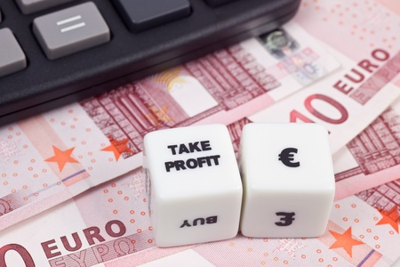 Euro currency with calculator and dice showing TAKE PROFIT photo