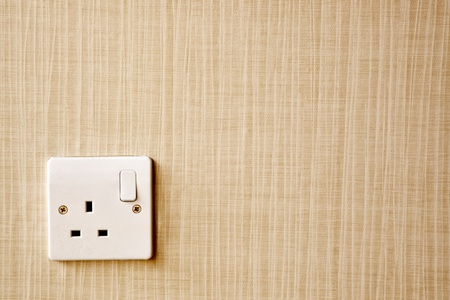 power socket at the corner of a wall  photo