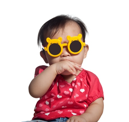 Playful Asian toddler girl with sunglasses isolated on white background Stock Photo - 8681800