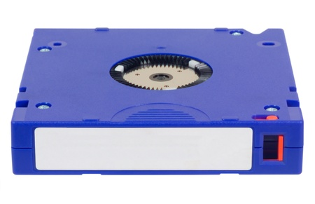 secure backup: Blue colored computer backup tape for data recovery isolated on white background