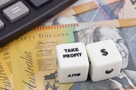 Australian currency with calculator and dice showing TAKE PROFIT photo