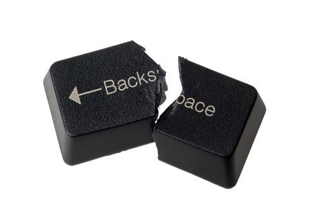 rectify: Tasto BACKSPACE tagliata a met� non raffigurante Annulla isolato su sfondo bianco Archivio Fotografico