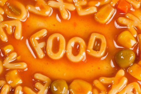 Alphabet shaped pasta forming the word FOOD in tomato sauce photo