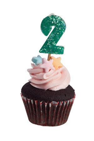 Mini cupcake with birthday candle for two year old isolated on white background Stock Photo - 9924864