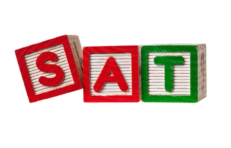 sat: Wooden blocks forming the letters SAT isolated on white background Stock Photo
