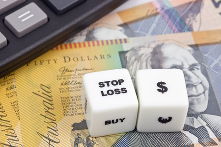 Australian currency with calculator and dice showing STOP LOSS