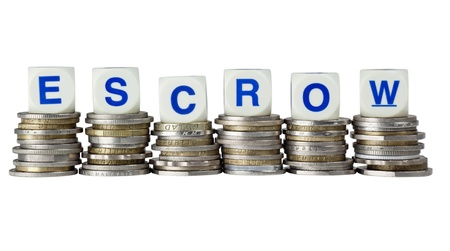 in escrow: Stacks of coins with the word ESCROW isolated on white background