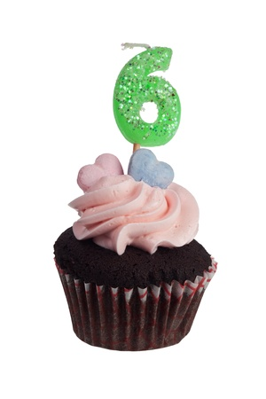 Mini cupcake with number six candle for six year anniversary isolated on white background photo