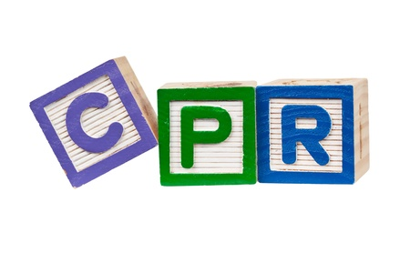 cpr: Wooden blocks forming the letters CPR isolated on white background