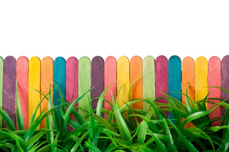 blockade: Colorful toy fence and grass against white background Stock Photo