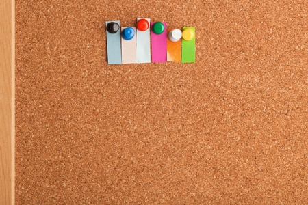 Cork board and colorful heading with copyspace for a six letter word photo
