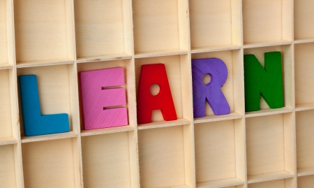 language learning: Wooden letter blocks forming the word LEARN Stock Photo