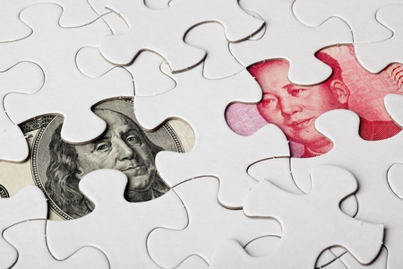 US and Chinese currencies as part of a jigsaw puzzle Stock Photo - 12525162