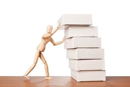 wooden mannequin: Figurine stacking a stack of white boxes Stock Photo