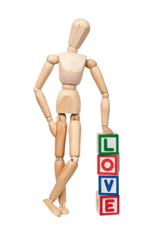 adore: Wooden figurine with the word LOVE isolated on white background