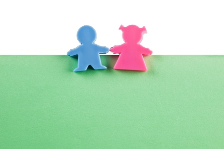 conjugal: Man and woman figurine on a piece of blank colored paper Stock Photo