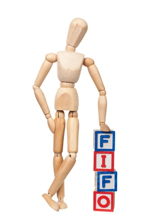 wooden doll: Wooden figurine with the letters FIFO isolated on white background