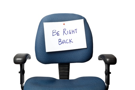 absent: Office chair with a BE RIGHT BACK sign isolated on white background