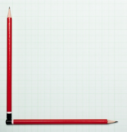 axis: Blank graph paper with pencils as axis Stock Photo