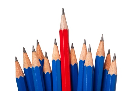 conspicuous: Red pencil standing out from a bunch of blue pencils isolated on white background