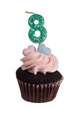 aniversary: Mini cupcake with number eight candle for eight year aniversary isolated on white background