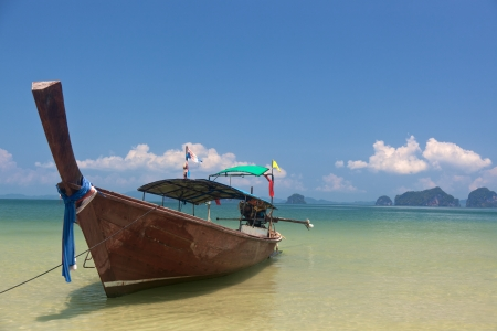 longtail: Longtail boat on the shore in Krabi, Thailand Stock Photo