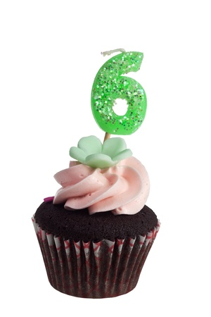Mini cupcake with birthday candle for six year old isolated on white background  photo