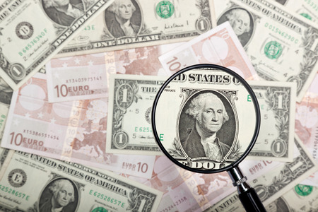 Focusing on US dollar note against US and Euro currencies  photo