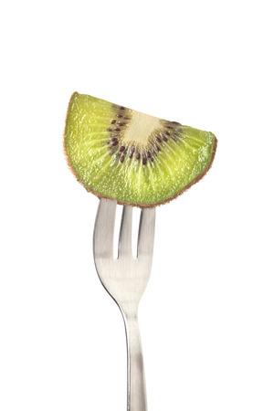 kiwifruit: Slice of kiwifruit held by a fork isolated on white background