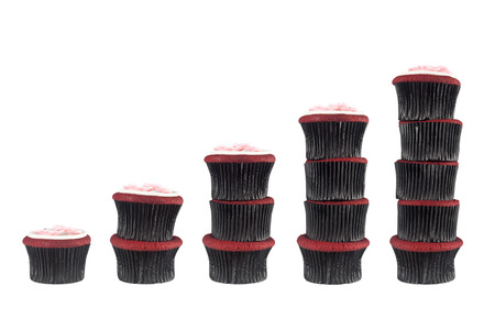 Sequence of stacks of muffins from one to five isolated on white background photo