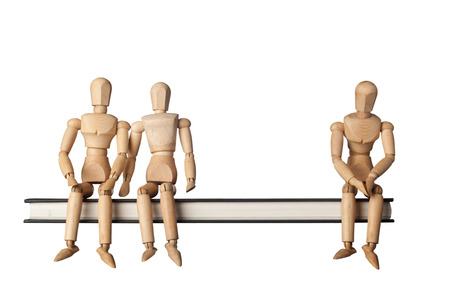 social outcast: Relationship between three people depicted by three figurines isolated on white background