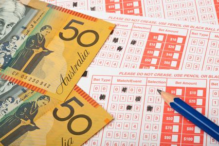 australian money: Closeup of Aussie money and sports betting slip  Stock Photo