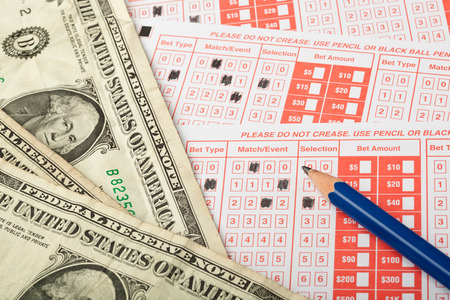 cash slips: Closeup of sports betting slip with US money