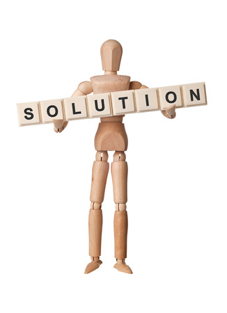 Wooden figurine with the word SOLUTION isolated on white background Stock Photo