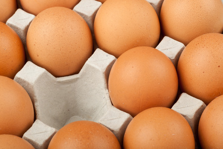 omitted: A tray of chicken eggs with one missing
