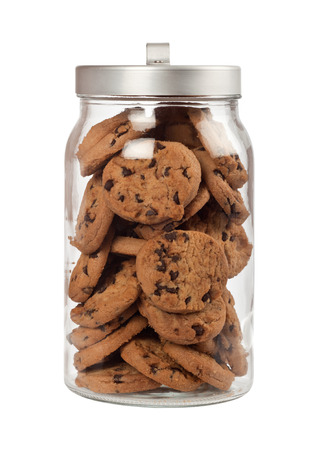 Jar full of chocolate chip cookies isolated on white background Foto de archivo
