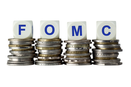 federal: Stacks of coins with the letters FOMC isolated on white background Stock Photo