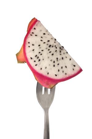 dragonfruit: Slice of dragonfruit on a fork isolated on white background
