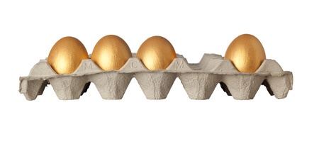 omitted: One golden egg missing from a tray of golden eggs isolated on white background Stock Photo