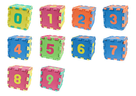 arabic numeral: Toy blocks forming cubes with the number zero to nine isolated on white background
