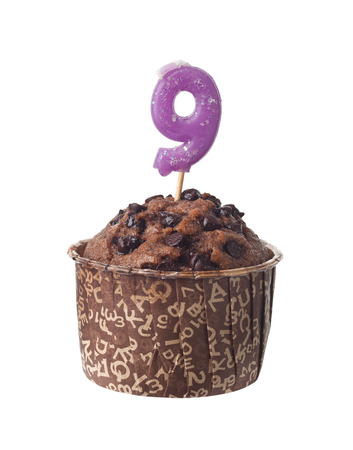 nine year old: Chocolate muffin with birthday candle for nine year old isolated on white background Stock Photo