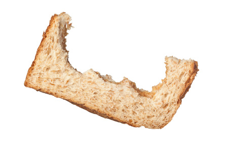 wasteful: Bites taken off a slice of bread leaving only the crust isolated on white background Stock Photo